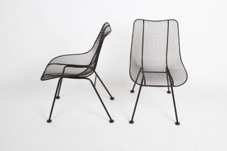 Satin black Woodard sculptura mesh dining chairs, restored condition. These chairs have been sand blasted, dipped in rust inhibitor primer and painted in satin black. New glides to bottoms of chairs.
