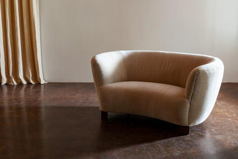 Danish two-seat curved cabinetmaker sofa with beech legs, reupholstered in Leo Schellens mohair velvet, 1940s.