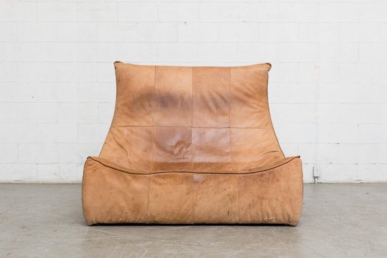 Two-seat natural leather sofa designed by Gerard van den Berg for Montis, 1970. Amazing piece of furniture design! In original condition, great patina, visible wear to leather, some staining, seat seam unravelling and evidence of cat claws to seat