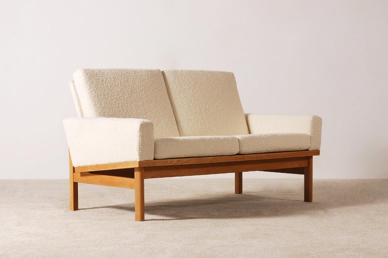 Nice oak frame and Bouclé fabric sofa by the Danish designer Poul Volther, Denmark, circa 1960s.  This sofa have been fully restored and newly upholstered with a high quality wool