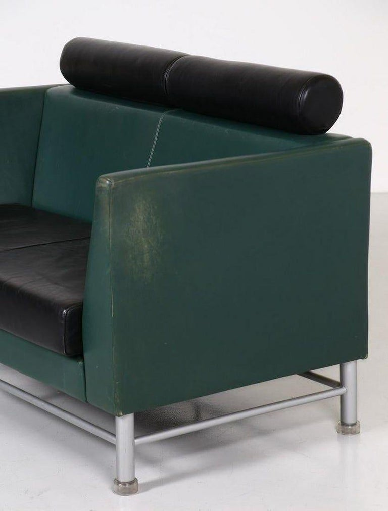 These two-seat sofa and armchair are an original pieces of design furniture designed by Ettore Sottsass for Knoll in the 1980s.  Made of metal and skai, with east side model, in black and dark green.  Two-seat dimensions: cm 134 x 85 x