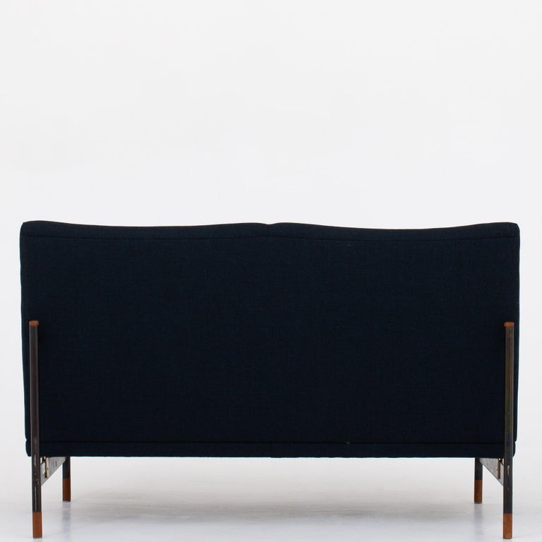 BO 141/2 - 2-seat sofa, upholstered in Remix 2 fabric (code 873) on a oxidized steel frame with teak details. Rare model. Maker Bovirke, 1953.