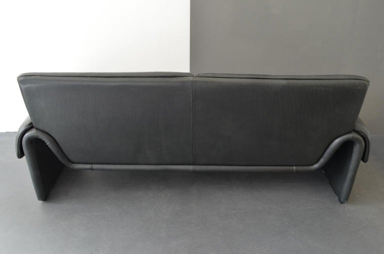 """Two-seat sofa """"DS-2011/12"""" by De Sede Factory Design, Switzerland, 1960s. Upholstered with black leather."""