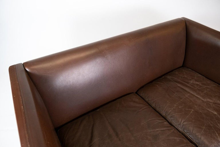 Scandinavian Modern Two Seater Sofa Upholstered with Dark Brown Leather of Danish Design, 1960s For Sale