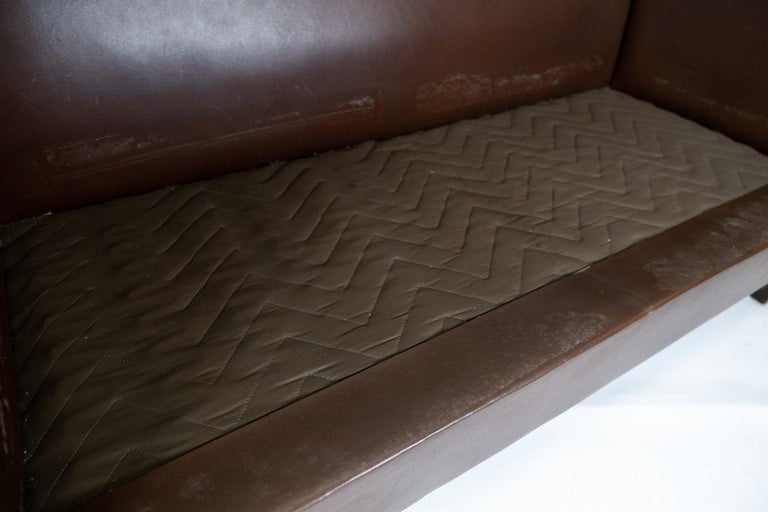 Mid-20th Century Two Seater Sofa Upholstered with Dark Brown Leather of Danish Design, 1960s For Sale