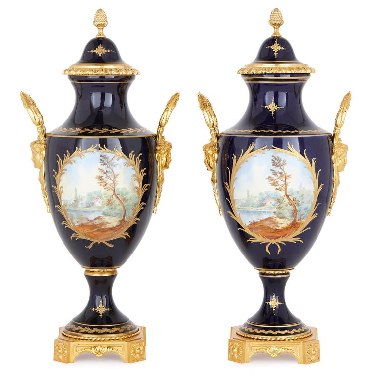 These Sèvres style vases are elegant works of decorative art, which have been finely painted, gilded and mounted in gilt bronze (ormolu). The vases are designed in a graceful Rococo style, which was characteristic of porcelain goods produced by the