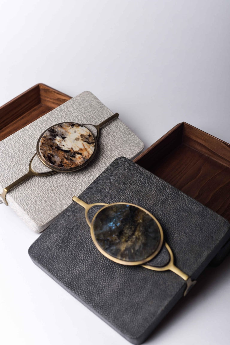The Set of 2 Victoria boxes are chic accent pieces for your home. The pieces are bejeweled with an elegant handle that has semi precious stone inserts. This comes as a set of two, option to purchase these boxes individually on request.  The