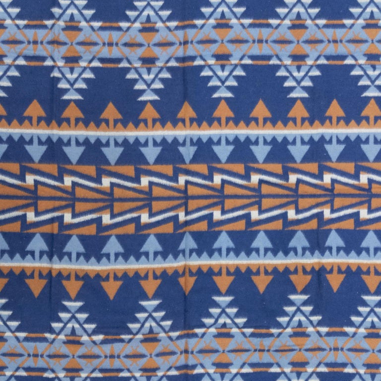 Two-sided cotton beacon blanket with geometric designs. Unused condition. 70