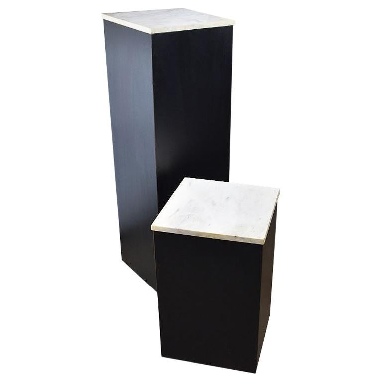 Two Square Black Marble and Wood Plinth Pedestals with Marble Tops, a Pair For Sale
