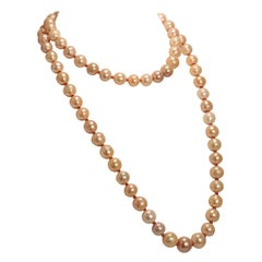 Two Strand Necklace of Lustrus Peachy Pearls with Orange Sapphires
