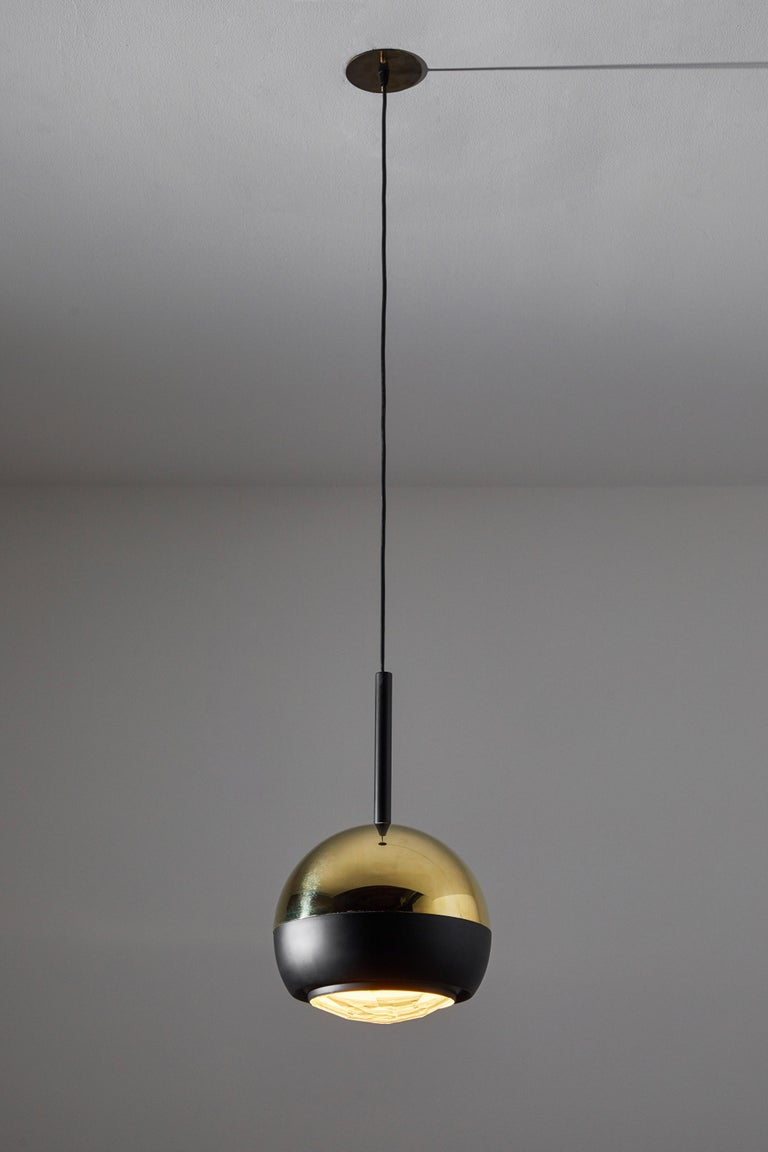 Two suspension lights by Stilnovo. Manufactured in Italy, circa 1960s. Brass, with faceted glass diffuser. Rewired for U.S. junction boxes. Custom brass ceiling plates. Each light takes one E27 60w maximum bulb. Bulbs provided as a one time