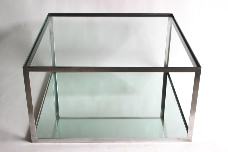Two-tier Aluminium frame coffee table with clear glass top and a mirrored shelf on the bottom