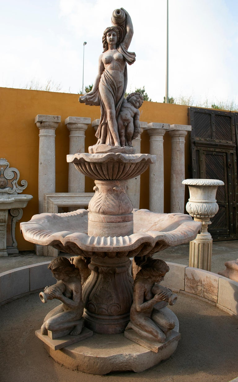 Two tier hand carved brown marble fountain with pool and sculptures.  Fountain dimensions: 305 x 160 x 160 cm Pool dimension: 34 x 290 cm.