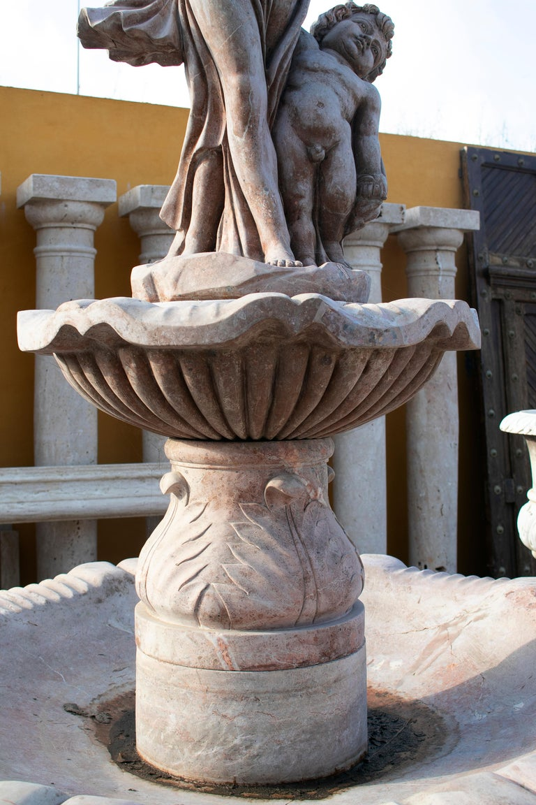 Two Tier Hand Carved Brown Marble Fountain with Pool and Sculptures In Good Condition For Sale In Malaga, ES