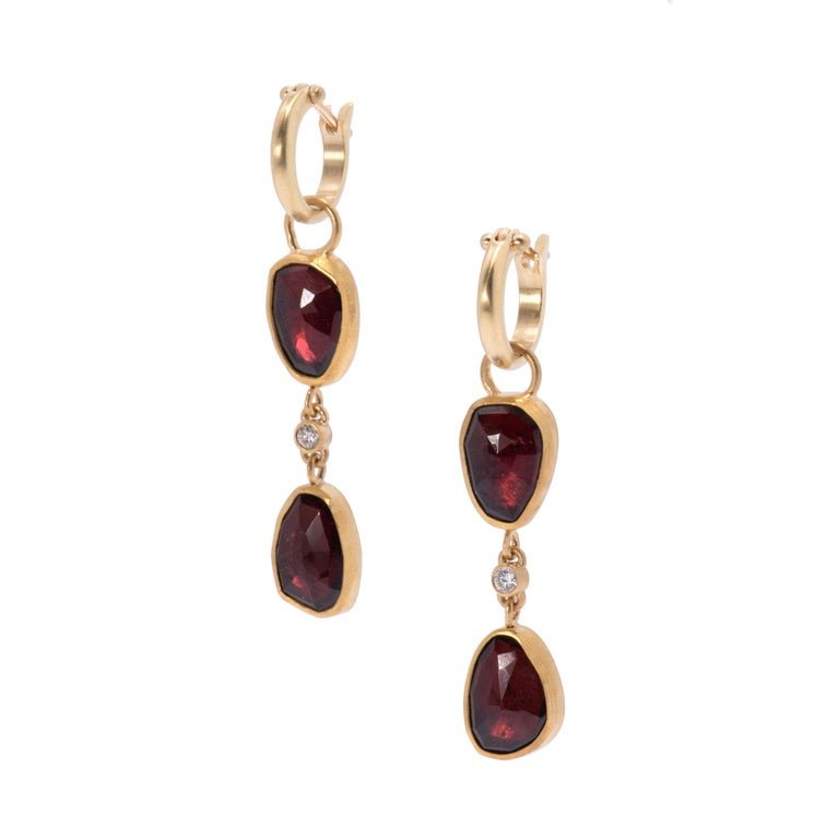 Rose Cut Garnets are set in 22 karat gold and hang tiered in pairs with winking .12 tcw diamonds and are suspended from small 18 karat gold plain hoops. Each rose cut garnet is unique as are the bezel settings which are backed in sterling silver.