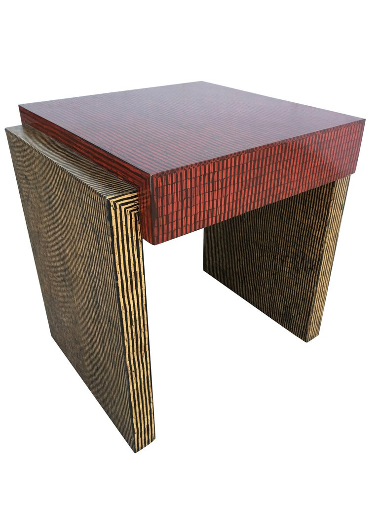 Two-tone cubist style side table pair with red and tan textured vinyl tops.