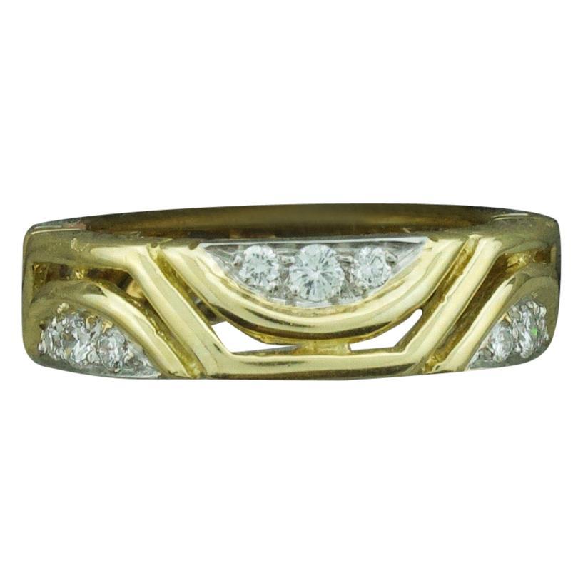 Two-Tone Diamond Eternity Ring in 18 Karat White and Yellow Gold