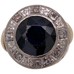 Two-Tone Gold Ring Diamonds Flanking a Sapphire