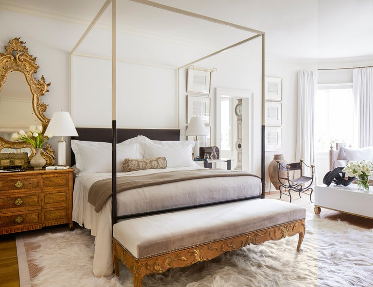 This ultra-sleek and streamlined two-tone iron canopy bed with upholstered headboard from the custom Tara Shaw Maison collection has been featured in several shelter magazines, including Veranda and Architectural Digest. Handcrafted in New Orleans.