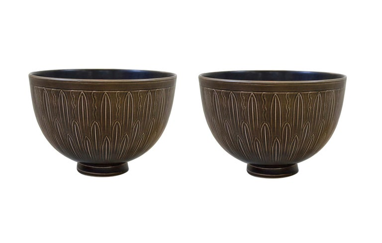 Two large and rare bowls from the 'Solbjerg' series, from Nils Johan Thorvald Thorsson (1898–1975) earlier work for Aluminia and marked. Measures: Ø 28.5 x H 19.5 cm.  Nils Johan Thorvald Thorsson is regarded as one of the best designers of Royal
