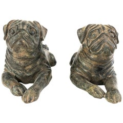 Two Vintage Cast Iron Pug Dog Sculptures