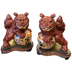 Two Vintage Ceramic Chinese Pho Dogs on an Hand Painted Wood Base, circa 1950