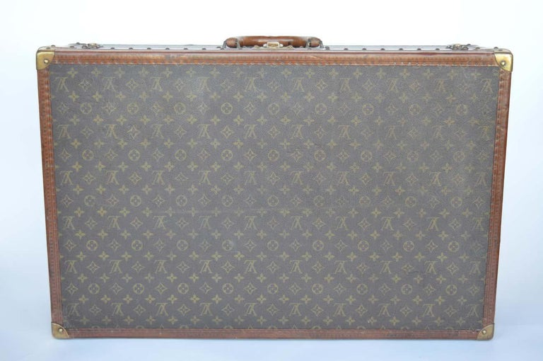 Leather Two Vintage Louis Vuitton Trunks For Sale