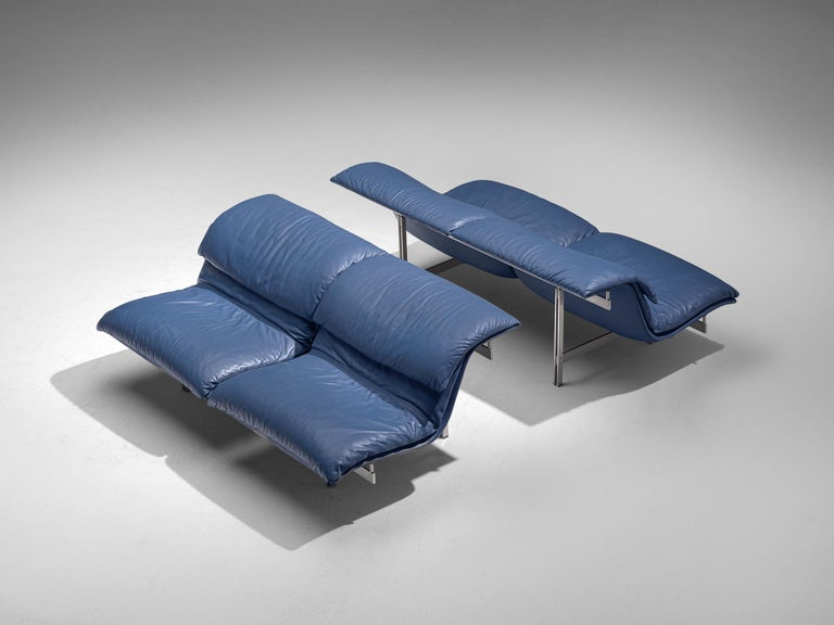 Giovanni Offredi for Saporiti, two sofas, dark blue leather, steel frame, Italy, 1970s.  These iconic wave sofas are designed by Giovanni Offredi in postwar Italy. The design for this sofa is dynamic, sculptural and figurative. The sofa is