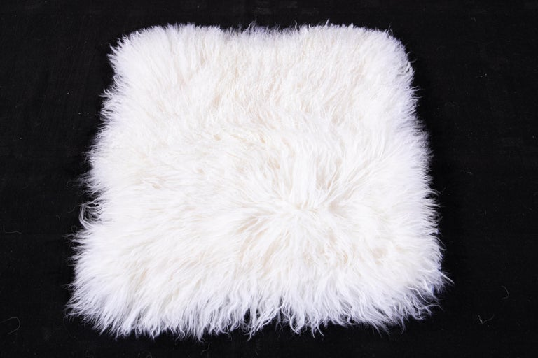 Beautiful modern Tibetan fur pillows cover with an ivory field. Tibetan fur is widely touted as one of the highest quality sheep furs.  These pillows cover measures: 18