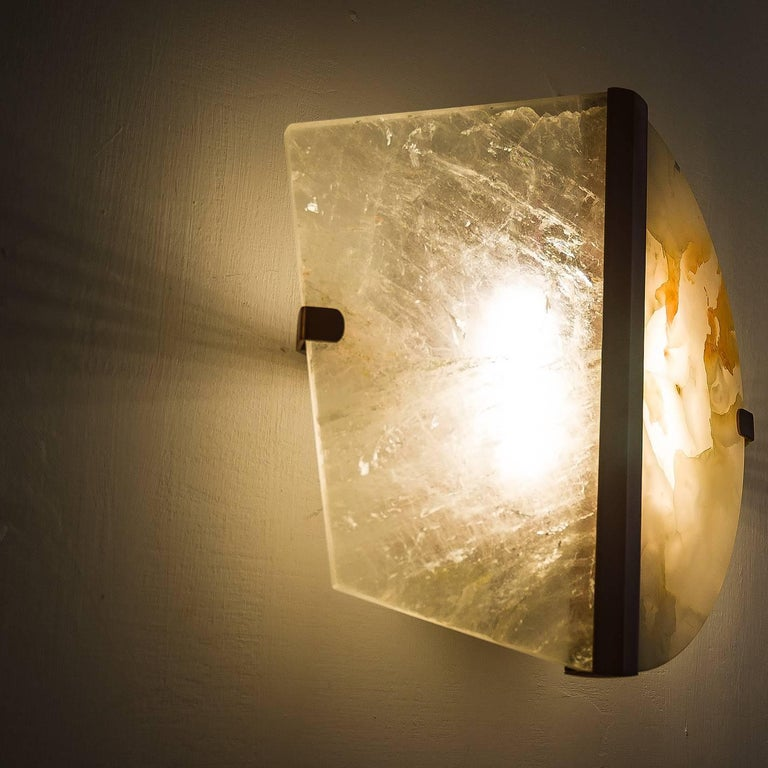This wall lamp is a contemporary piece, made in Tuscany Italy, entirely handmade, 100% of Italian origin.  Sculptural, essential and precious, this lamp is an art object of elegant decoration for all kinds of interiors, from Classic style to modern