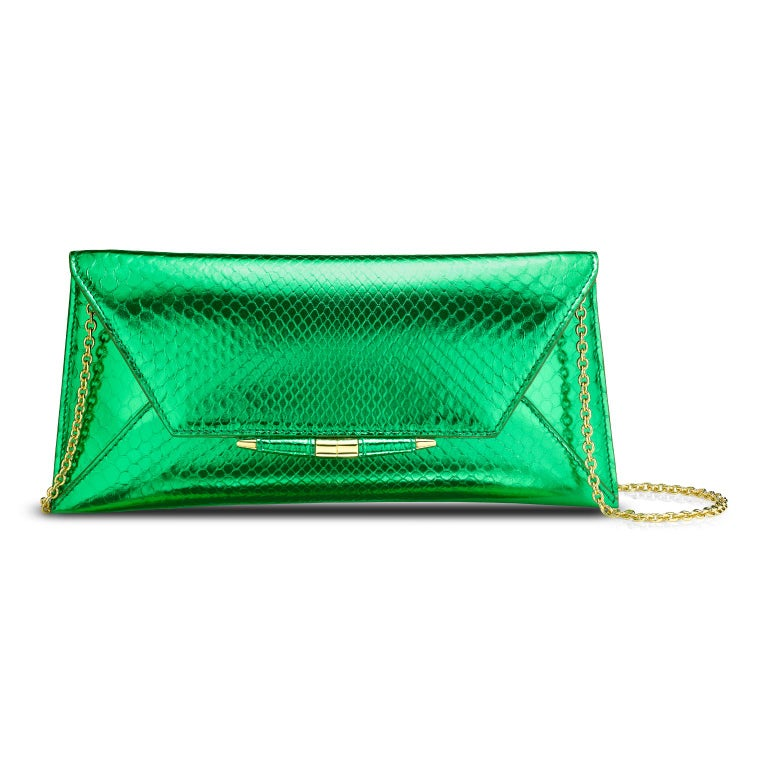The Aimee Clutch large is featured in our Kryptonite Python with gold hardware. The clutch is designed with a three-quarter front flap, a magnetic snap closure and is finished with our custom Infinity Bar. It fits the large iPhone, has a hidden