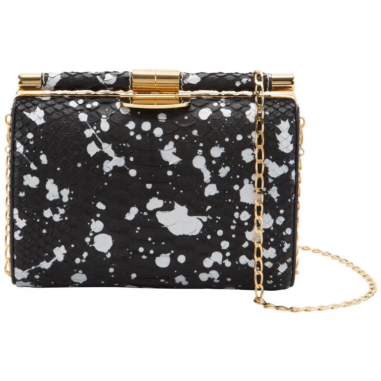 Anjuli medium clutch in black/white splash python