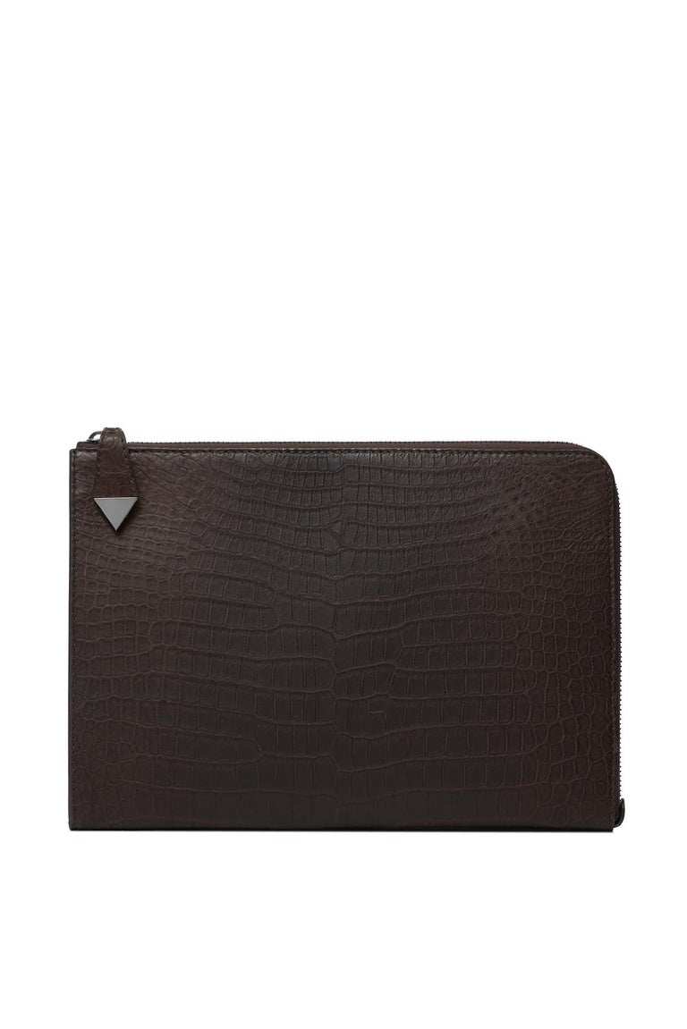 """The Ben Attache features a three quarter external zip, metal snap closure, our interior super pocket and is lined with out signature Thayer blue nylon.  Size: One Size Hardware: Gunmetal Interior/Lining: Suede Dimensions: 14.0"""" W x 10.0"""" H x 1.0"""" D"""