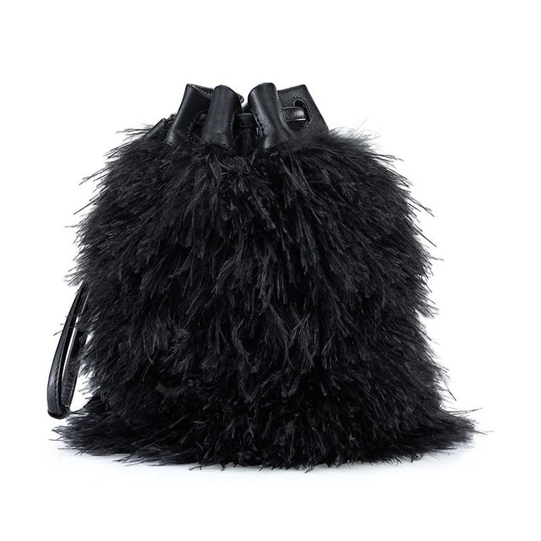 The Grace is a soft pouch with Black Ostrich Feathers and has a Black Leather drawstring closure. It fits the large iPhone, has internal card slots and features our signature Thayer Blue lining.   Size: Small