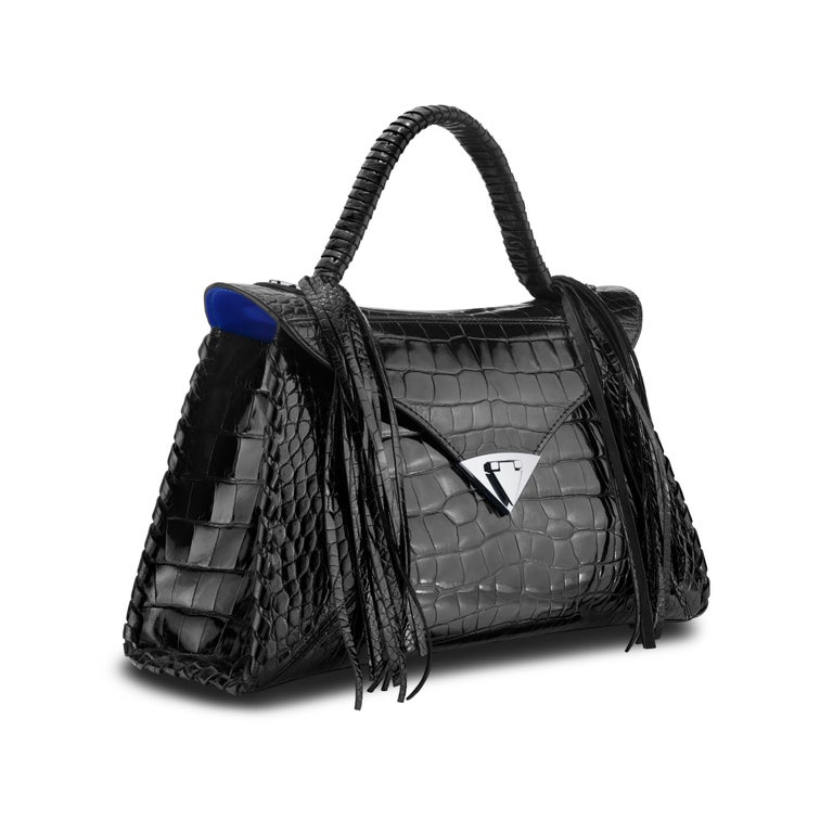 *Note this is a Made to Order Listing. Please allow 4-6 weeks for your timeless handbag to arrive.*  This extremely rare black alligator LJ Handbag is finished in a special Bombè treatment, which leaves the skin with an incredible sheen, while