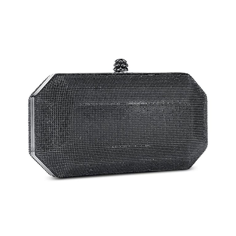 The Perry Clutch Small in Gunmetal Swarovski Crystal Fine Mesh is a hard-framed clutch designed with interior pockets and an optional gunmetal cross-body chain. It's elegant emerald shape is inspired by Tyler's own engagement ring and named after