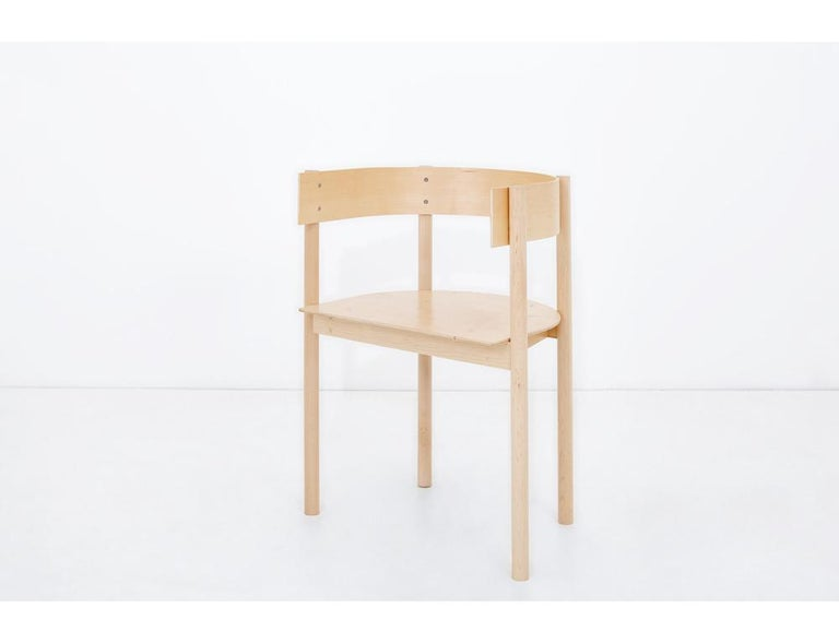 Typecast chair strikes a perfect balance between curve and line, soft and hard. Made from bent and laminated plywood with a solid maple frame.