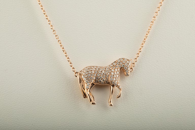 Ubaldi Gioielli, Equestrian jewelry, hand made in Italy,  exclusive design and manufacture, this horse pendant, with a very fine design and an amazing Diamonds pave setting, has a rolo 18kt rose gold chain and adjustment HorseBites links for an easy