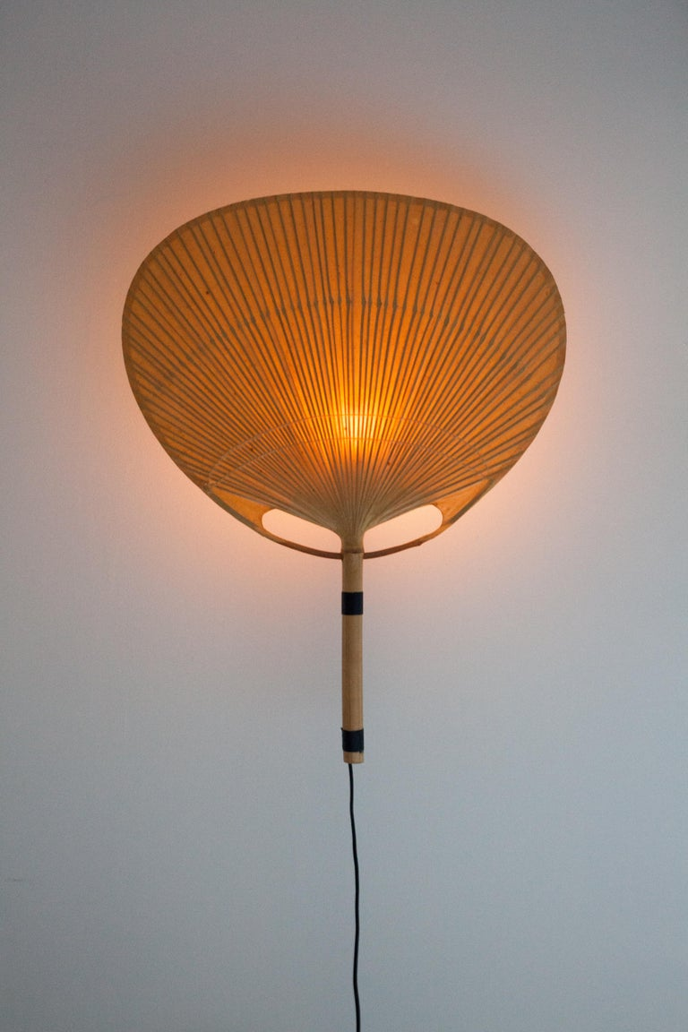 Iconic bamboo fan sconce by Ingo Maurer, Germany, 1079s.   The Uchiwa fans are traditional Japanese hand fans and Maurer applied the same paper and bamboo techniques to create his wall sconces.