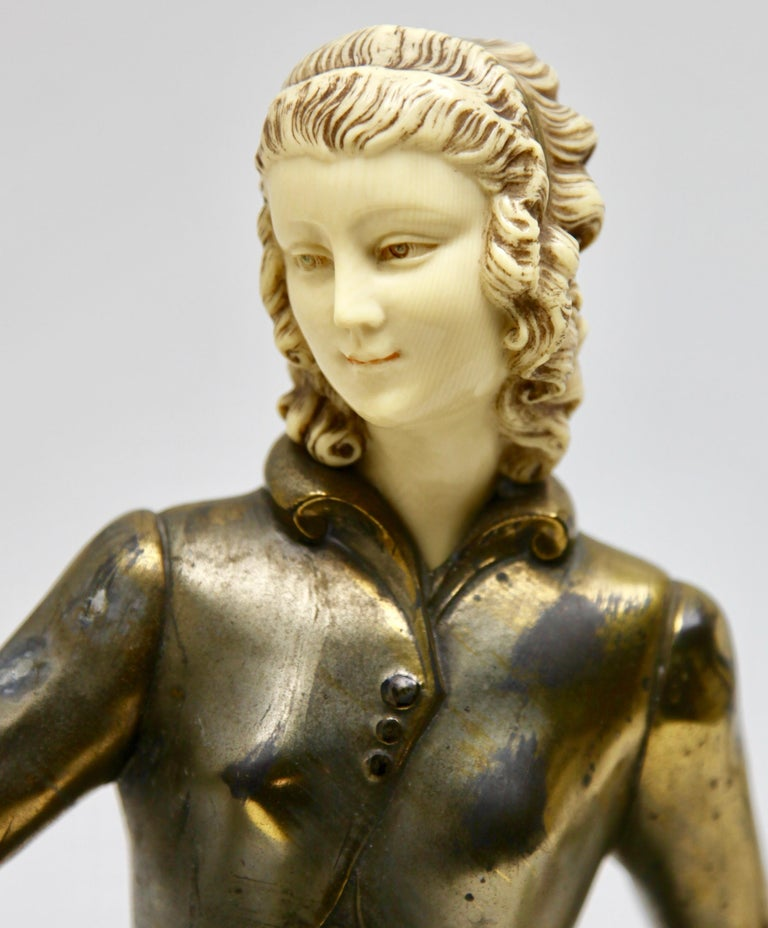 This large Art Deco, 1930s figural sculpture is a great statement piece and is signed 'Menneville', a pseudonym for the late 19th–early 20th century artist Ugo Cipriani (1887-1960, aka Ugiano) a well-established sculptor of the Art Deco