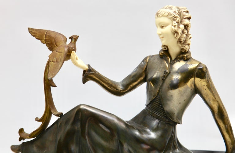 French Ugo Cipriani Art Deco Statuette, Woman with Birds of Paradise, Signed Menneville For Sale