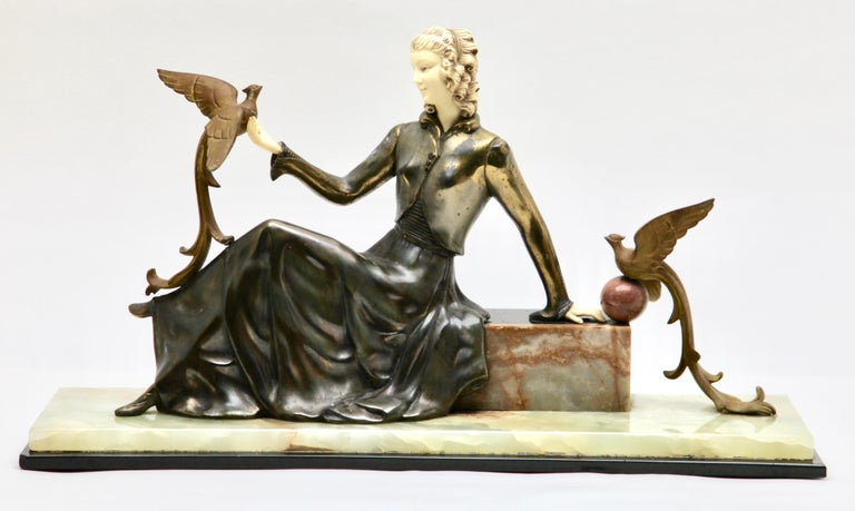 Early 20th Century Ugo Cipriani Art Deco Statuette, Woman with Birds of Paradise, Signed Menneville For Sale