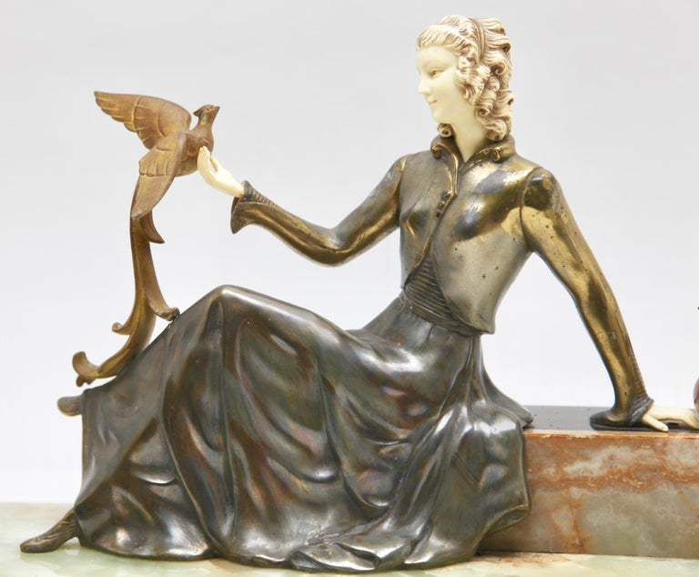 Spelter Ugo Cipriani Art Deco Statuette, Woman with Birds of Paradise, Signed Menneville For Sale