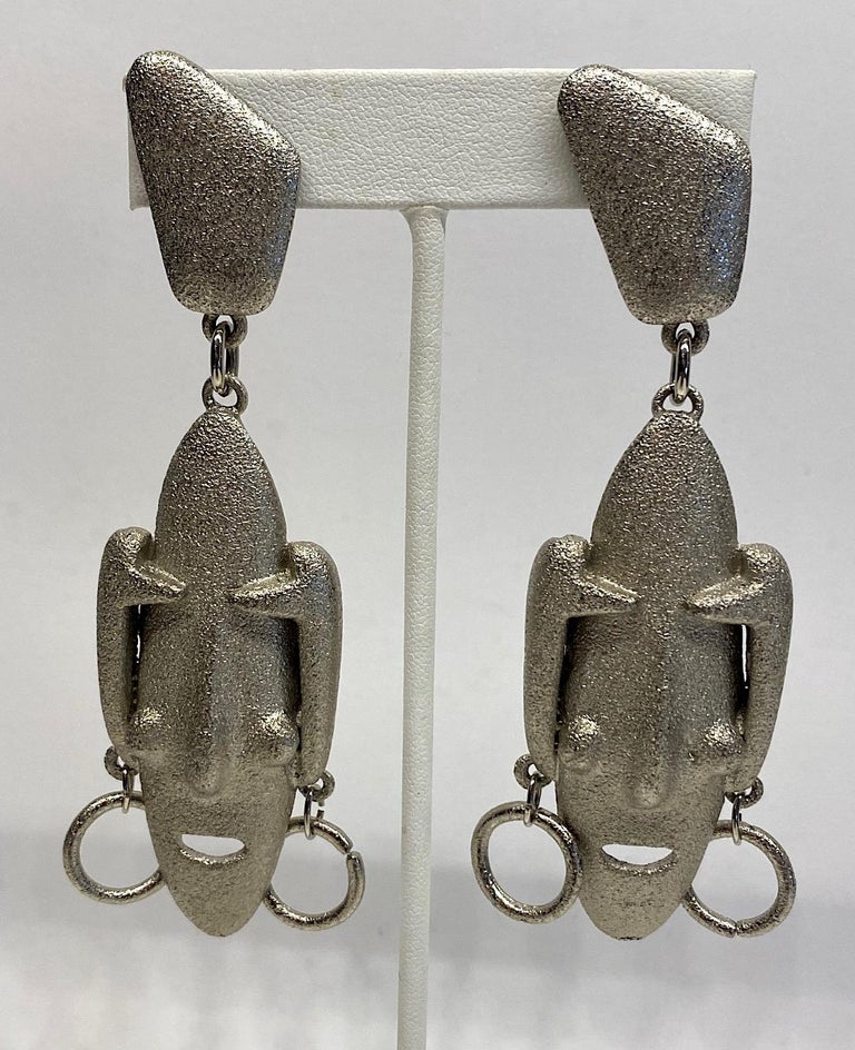 Italianjewelry and  fashion jewelry designer Ugo Correani 1980s large face pendant earrings in the style of Modigliani. Each of the elongated faces are reminiscent of the portraits of the artist Modigliani. They are cast and finished in a textured