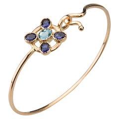 Ugolini 18Karat Yellow Gold Blue Iolite Blue Topaz Twisted Bangle Bracelet