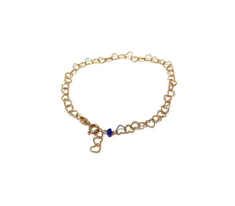 A romantic style bracelet embellished with a 0.30 karats deep blue sapphire that fits every outfit due to its semplicity. The chain is linked by hand and slightly hammered to fit the perfect bracelet shape. Sapphire is said to be the wisdom stone,