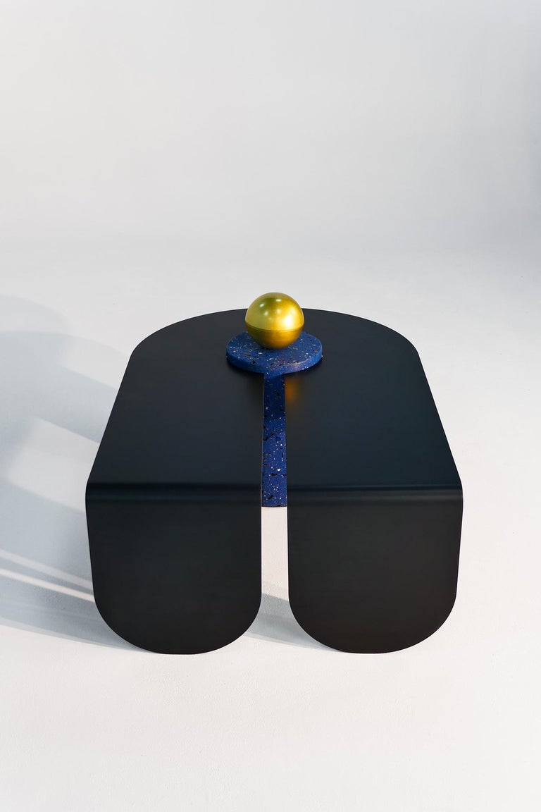 Juxtaposing highly distilled minimal forms with sensuous curves, the U & I coffee table is at once playful and minimal, with an anodized aluminum body and terrazzo supporting column topped by a spun brass storage box.   All parts are connected