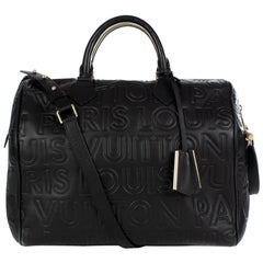 Ultra limited Louis Vuitton Speedy 30 handbag with strap in black leather