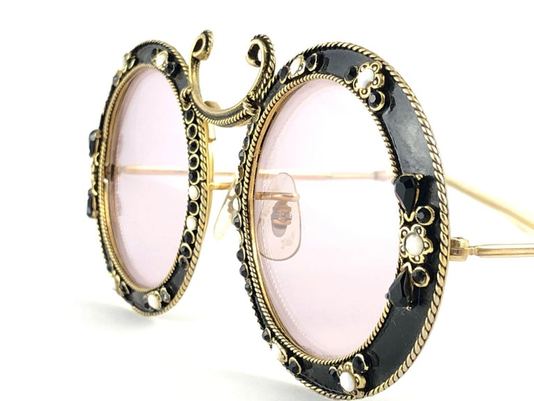 Ultra rare pair of Christian Dior Sunglasses circa 1960's by Tura.    This is a seldom and rare piece not only for its aesthetic value but for its importance in the sunglasses and fashion history.    Delicate enamel ornamented cast iron frame with