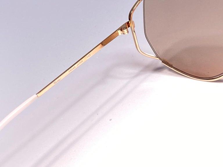 Brown Ultra Rare 1970's Tura 425 Oversized Gold & White Light Lenses Sunglasses For Sale